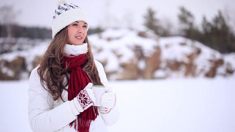 Winter Girl Drinks Tea Stock Video Footage