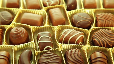 Chocolate box, sweet pralines background Footage