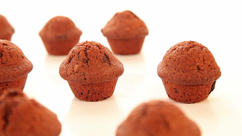 Chocolate cupcakes, muffins on white background Stock Video Footage