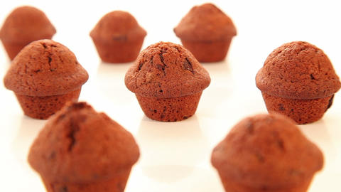 Chocolate cupcakes, muffins on white background Footage