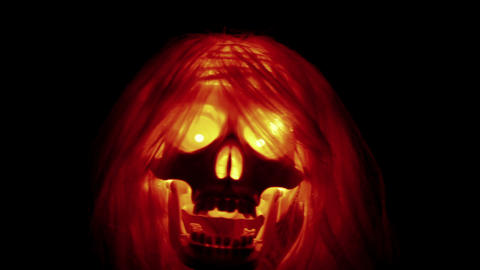 Spooky skull with hair flying halloween background Stock Video Footage
