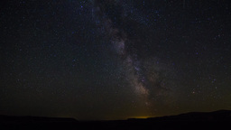 Milky way above horizon with lights movements Footage
