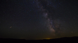 Milky way above horizon with lights movements Stock Video Footage