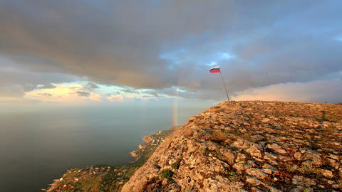 4K. Russian flag on the top of a mountain Stock Video Footage