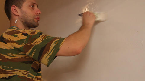 man painting with white paint 1 Stock Video Footage