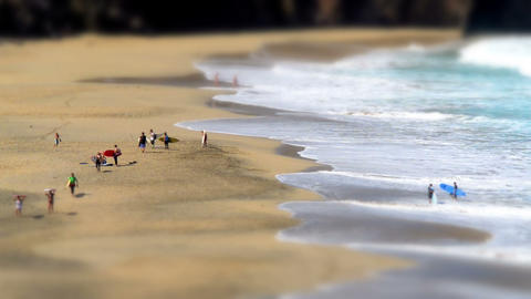 Surfer Leaving Nudist Beach Tilt Shift Time 11132 stock footage
