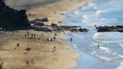 beach live surfers walk tilt shift time laps 11137 Stock Video Footage