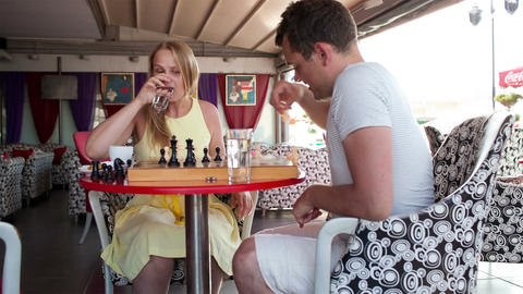 Smiling couple playing a game of chess Stock Video Footage