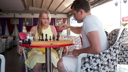 Smiling Couple Playing A Game Of Chess stock footage