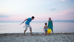 Young family playing tennis at the seaside Footage