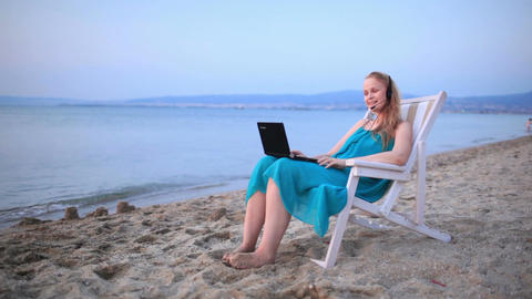 Woman talking skype at the beach Stock Video Footage