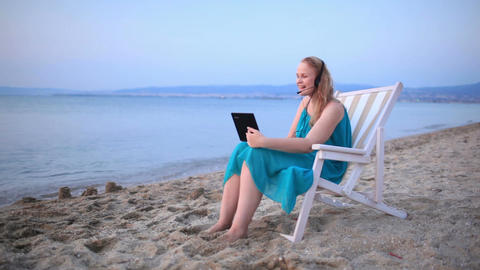 Woman talking skype at the beach Footage