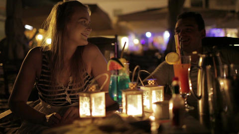 Romantic young couple enjoying drinks in a date Stock Video Footage