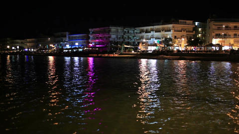 Illuminated waterfront buildings at night Stock Video Footage