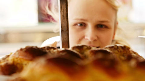 Young woman looking through bakery window Footage