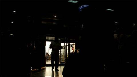 Silhouette Of Passengers In The Airport With Bags  stock footage