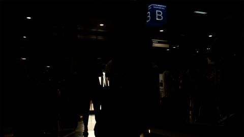 Silhouette of passengers in the airport with bags Stock Video Footage