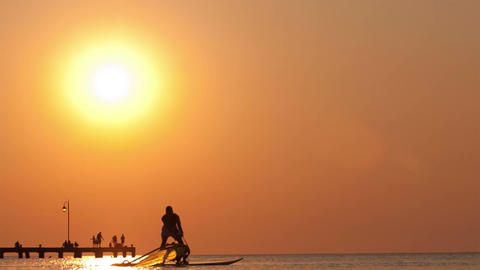 Silhouette of surfer at sunset Stock Video Footage