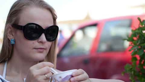 Woman eating ice cream in the street cafe Stock Video Footage