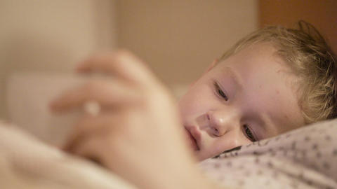 Kid is watching smart phone Stock Video Footage