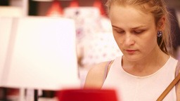Young woman in a lamp store Stock Video Footage