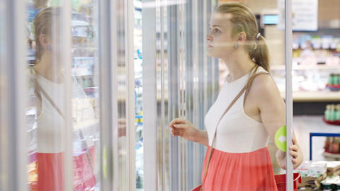 Young woman at the supermarket Stock Video Footage