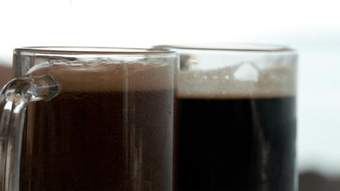 Pouring Black Beer Into The Beer Cup stock footage