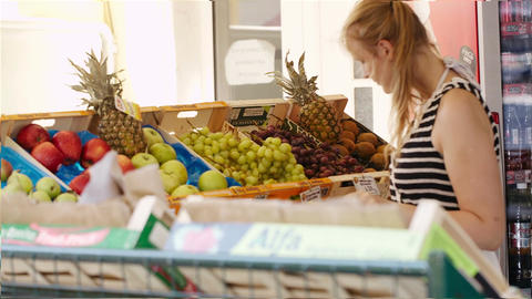 Young woman shopping for fresh fruit Stock Video Footage