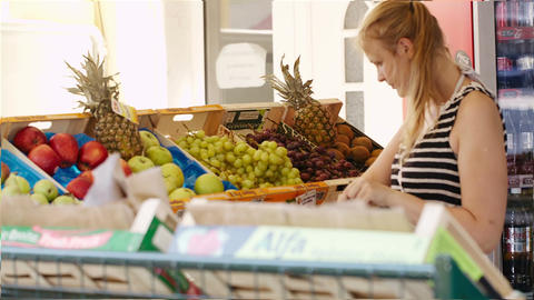 Young woman shopping for fresh fruit Footage
