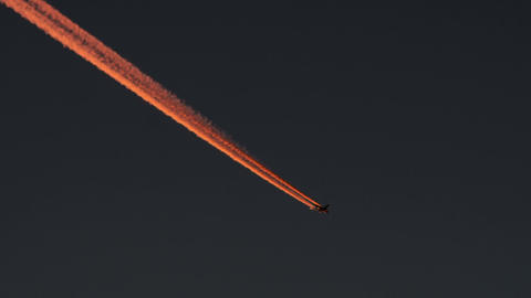 Airplane Contrails against dark sky Stock Video Footage