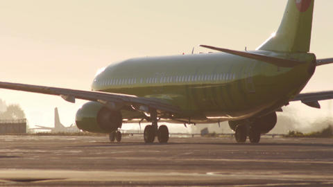 Airplane taxiing at dawn Stock Video Footage