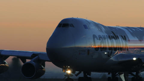 Big Cargo Plane Taxiing against Dawn Stock Video Footage