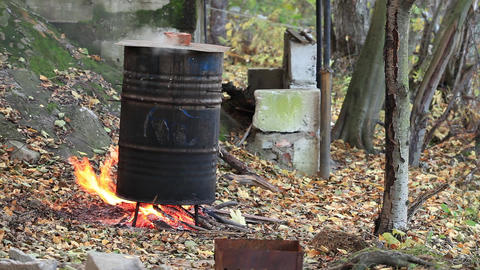cooking fish smoking in a barrel Footage