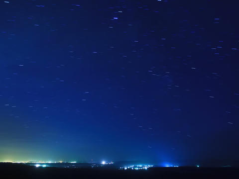 Stars leave traces above the city. Time Lapse. 4x3 Stock Video Footage