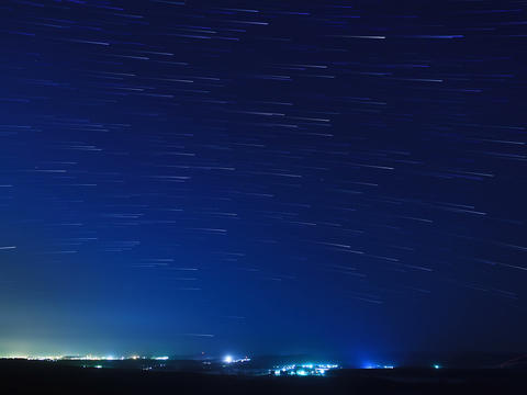 Stars leave traces above the city. Time Lapse. 4x3 Footage