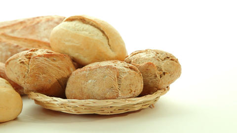 Fresh baked bread rolls in basket Stock Video Footage