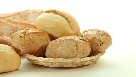 Fresh baked bread rolls in basket Stock Video Footage