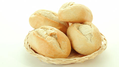 Fresh baked rolls in basket Stock Video Footage