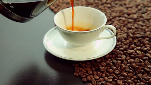 Pouring fresh hot coffee in white cup Stock Video Footage