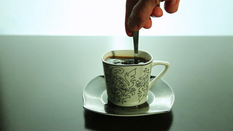 Stir with a spoon, coffee in a cup Stock Video Footage