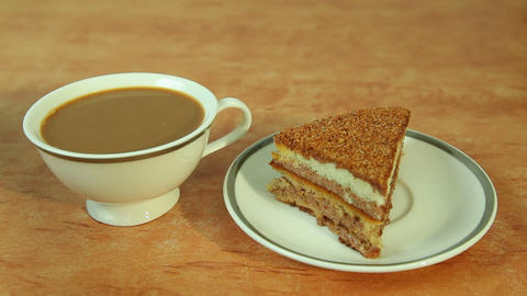 Cup of coffee with milk and piece of cake Footage