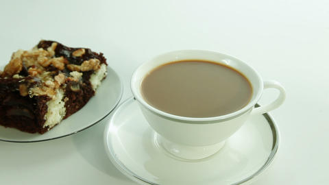 Cup of coffee with milk and chocolate cake Stock Video Footage