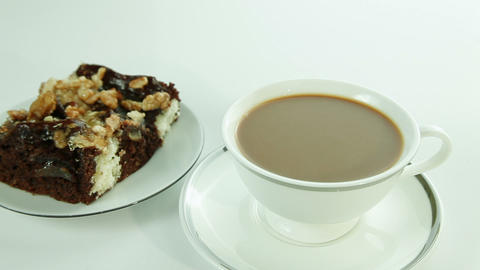 Cup of coffee with milk and chocolate cake Footage