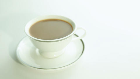 Cup of coffee with milk on white background Footage