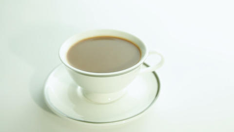 Cup of coffee with milk on white background Stock Video Footage