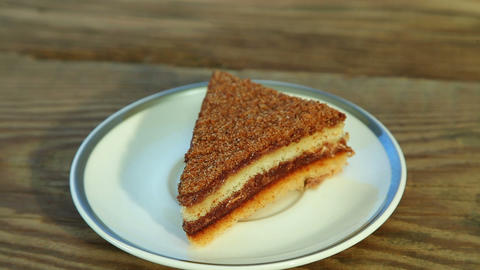 Sweet delicious cake with on plate Stock Video Footage