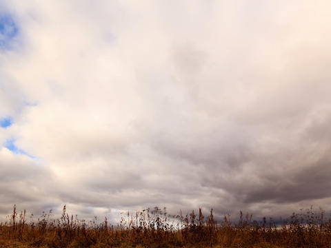 Clouds over dry grass. Time Lapse. 4x3 Stock Video Footage