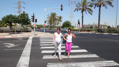 Two women cross the street Stock Video Footage