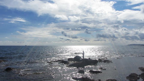 fisherman with spinning near sea in sunlight Footage