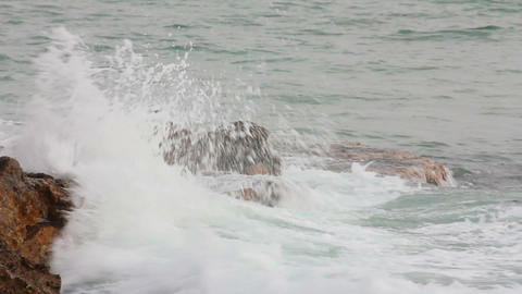 sea ??waves breaking on rock - slow motion Stock Video Footage